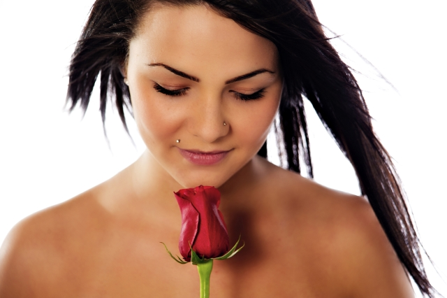 Girl with rose and nose piercing